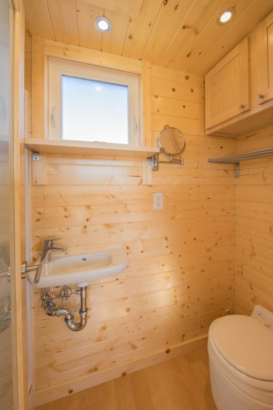The bathroom in the Vista Sport includes a shower, sink, and toilet