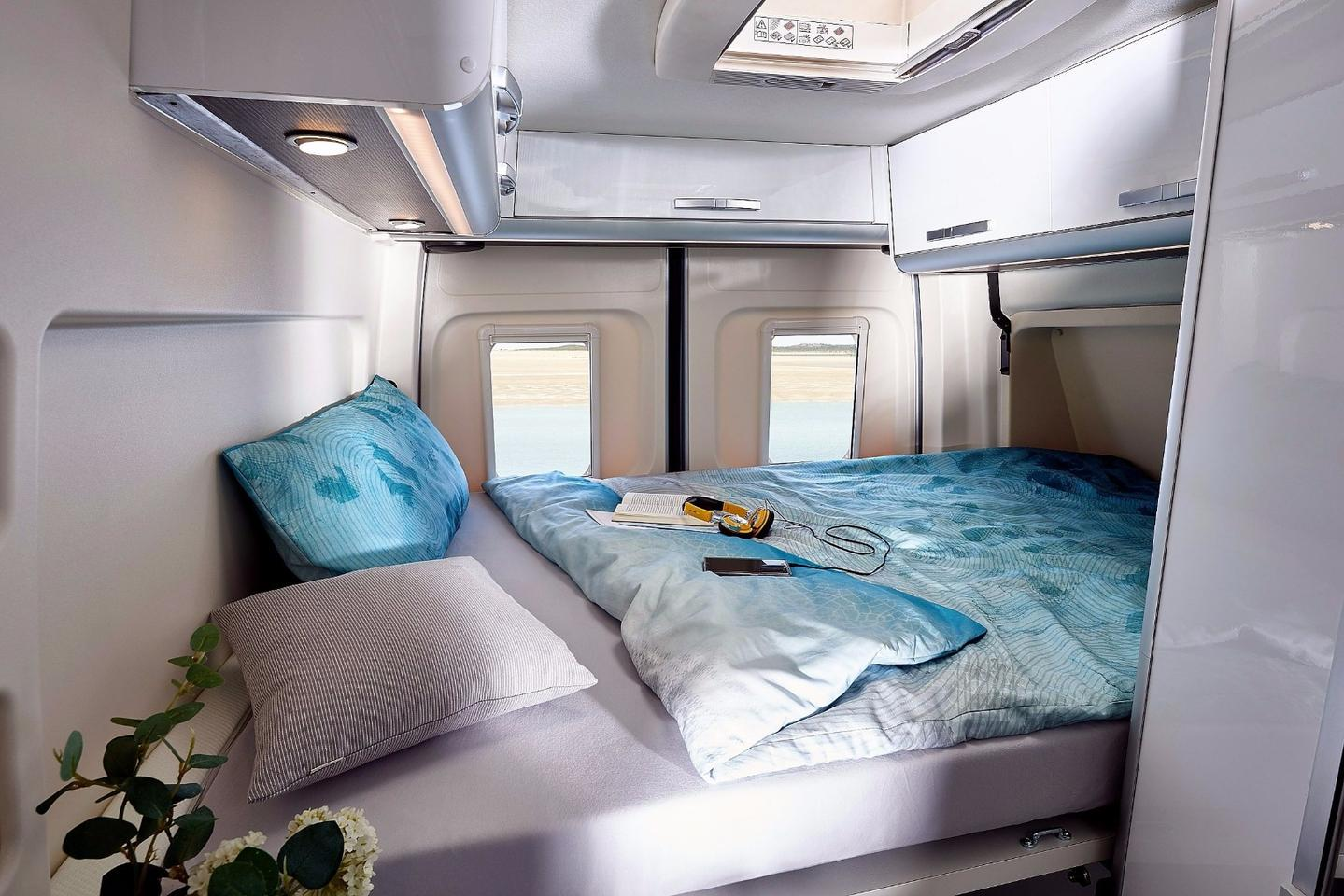 Westfalia opts for a transverse bed with an optional electrically extendablefoot box
