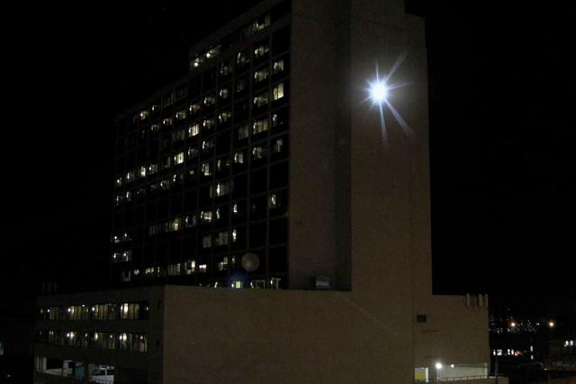 Adam Frank's SUNLIGHT at its peak, on the side of Denver's Minoru Yasui Building