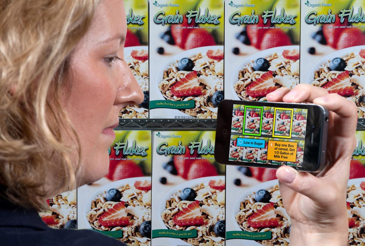IBM's Fiona Doherty demonstrates an augmented reality shopping app that automatically delivers personalized coupons, offers, customer reviews and hidden product details (Photo: Jon Simon/Feature Photo Service for IBM)