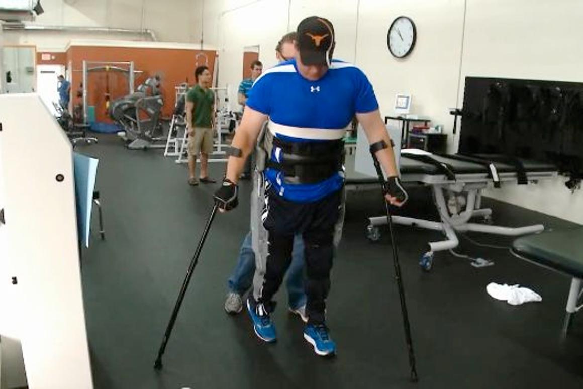 Test subject Brian Shaffer uses the prototype exoskeleton