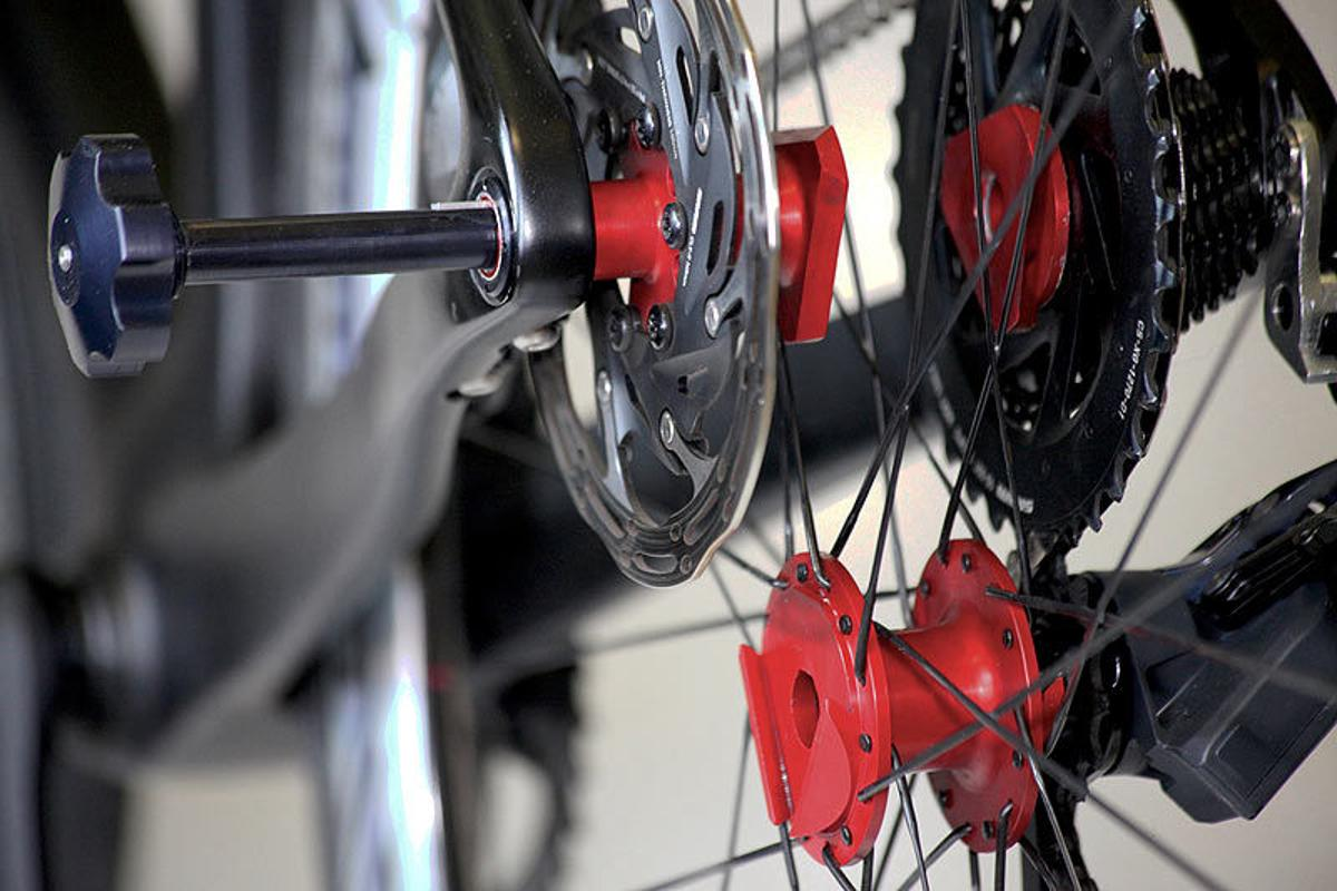 The Fasten system simplifies rear wheel removal by keeping the cassette, brake rotor and bearings attached to the frame