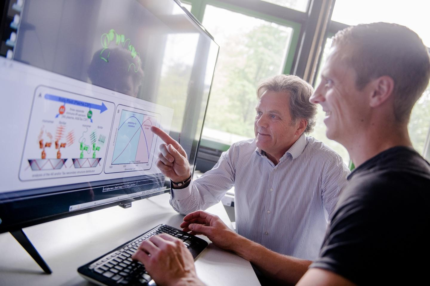 Klaus Gerwert (left) and Andreas Nabers suggest this new two-step diagnostic process will help Alzheimer's clinical trials recruit candidates at early stages in the disease progression, before clinical symptoms appear