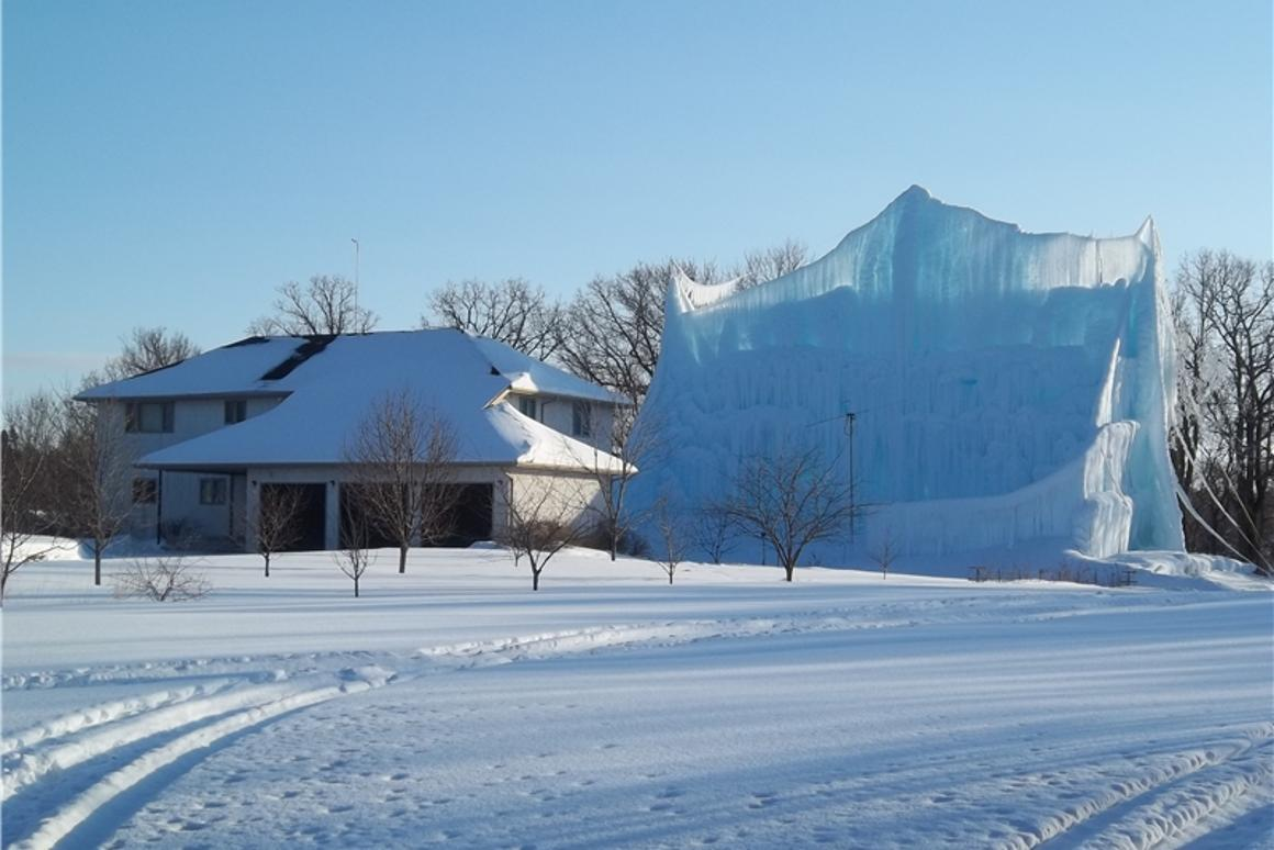 Roger Hanson's gigantic backyard ice sculpture for this year, made using water from his home's geothermal heating system