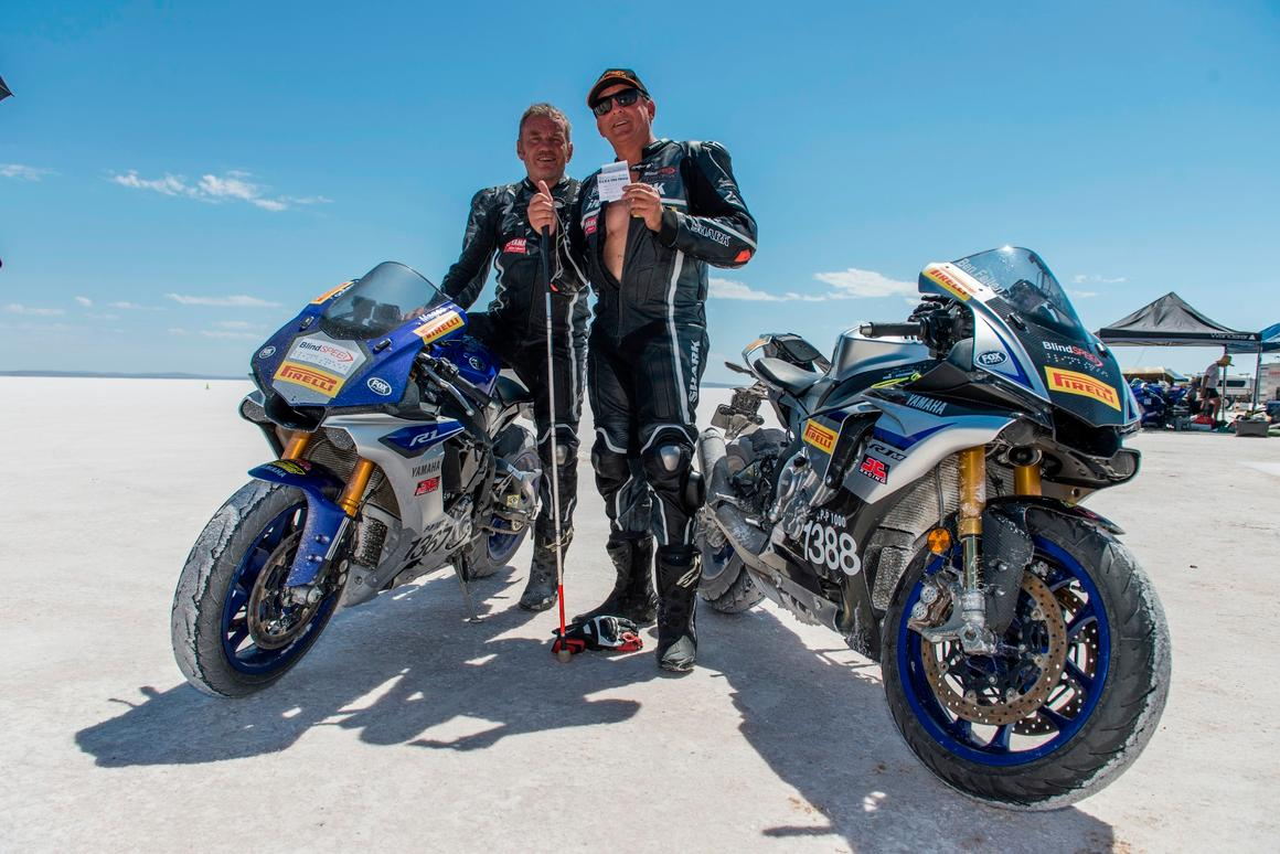 Blind land speed record holder Ben Felten celebrates with ex-MotoGP racer Kevin Magee after setting a blind motorcycle speed record last year. This year, on a new Kawasaki ZX-10, they hope to beat their 156.25 mph record from 2017
