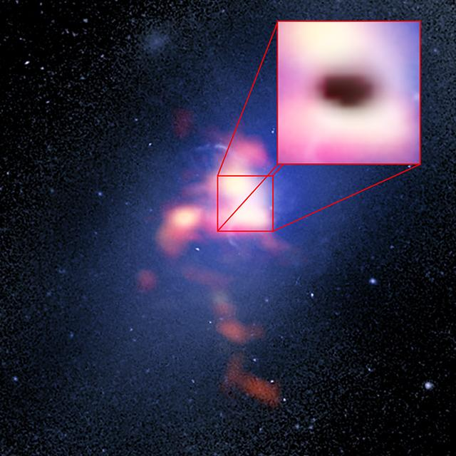 This composite image of Abell 2597 Brightest Cluster Galaxy has a blue background from the Hubble Space Telescope and red foreground from ALMA, while the box shows a shadow made by one of the cold clouds