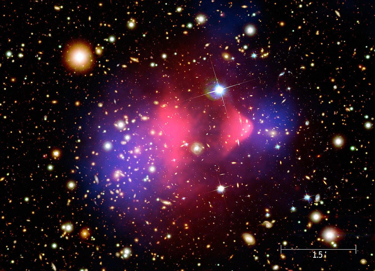 A composite image showing galaxies in optical light, X-ray emissions in pink and invisible mass – or dark matter – in blue