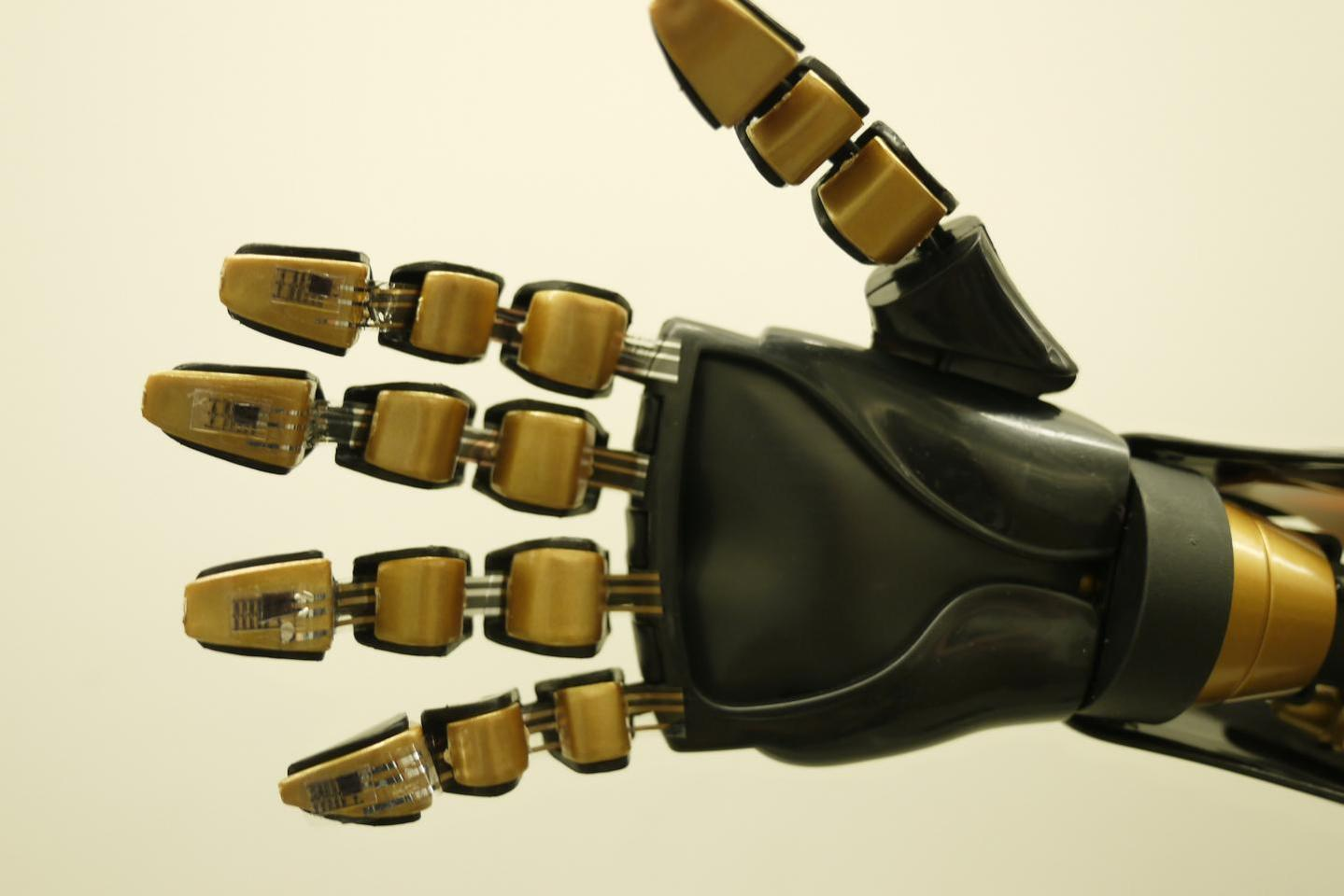 A robotic hand, with the touch-sensitive skin applied to its fingertips