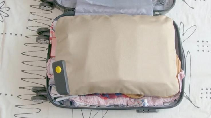 PaQ consists of a main device (lower left, in suitcase) that's attached to an inflatable bladder