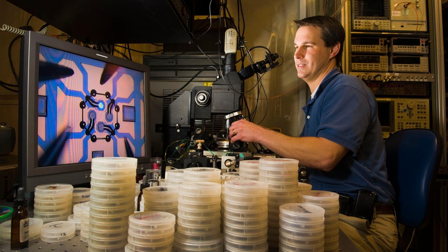 A technician measuring the wavelength of the CSAC's vertical-cavity surface-emitting laser (Photo: Sandia National Laboratories)