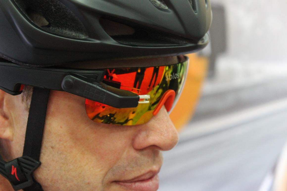 The Solos cycling glasses display performance metrics like heart rate, average speed and elevation