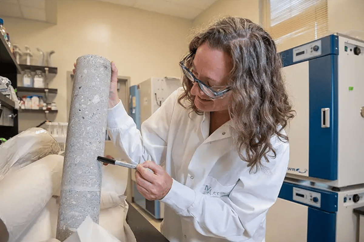 Lead author Julie Maresca with one of the concrete cylinders studied
