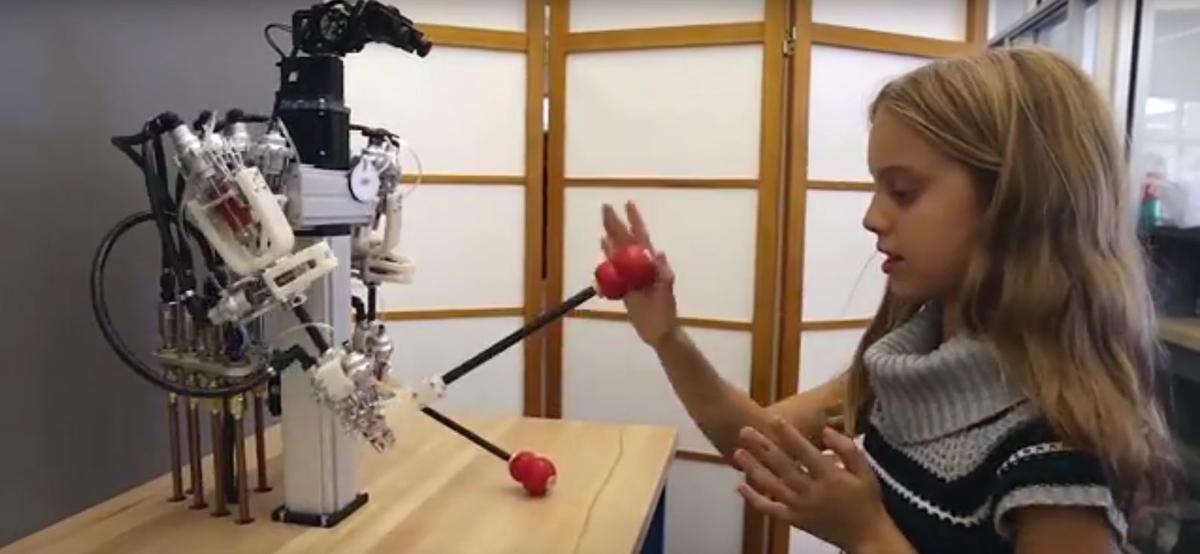The hybrid robot playing patty cake