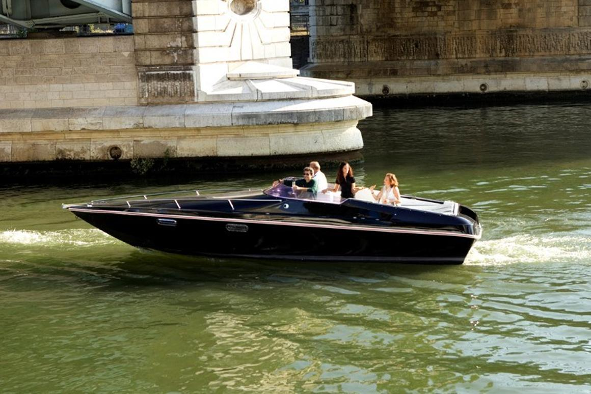 The Black Swan electric boat can carry up to eight people for 2 hour jaunts along the Seine in Paris