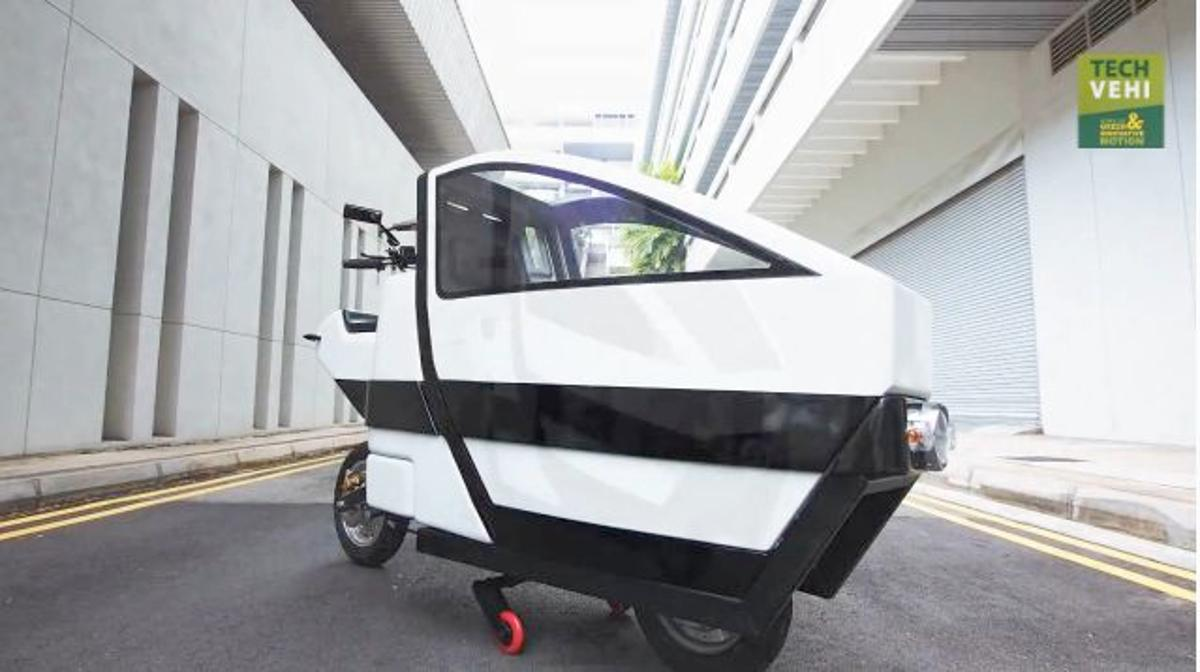 The VOI is a prototype electric scooter, in which the passenger sits in an enclosed compartment in the front