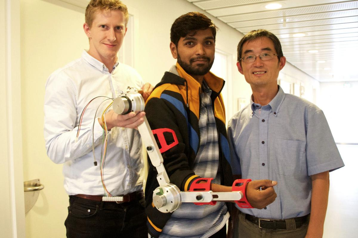 Aalborg University researchers Simon Christensen (left), Muhammad Raza Ul Islam and Shaoping Bai, with an arm brace designed for the AXO Suit