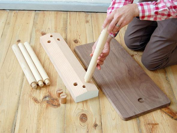 Building the Wood Peg furniture involves simply screwing the legs into place