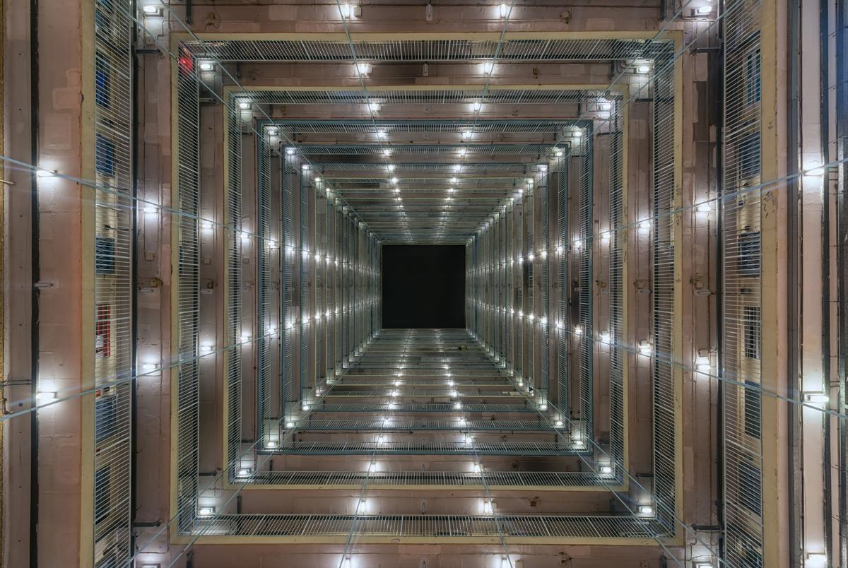 Herlan's photography looks up from the inside of massive apartment blocks in Hong Kong, revealing incredible symmetry