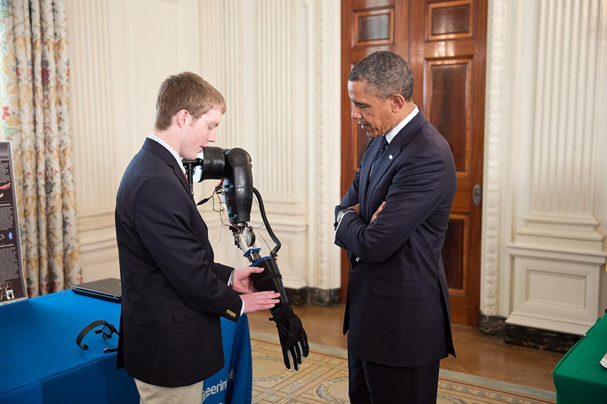 Easton LaChappelle demonstrates his prosthetic arm to President Barack Obama at the third annual White House Science Fair (Photo: The White House)