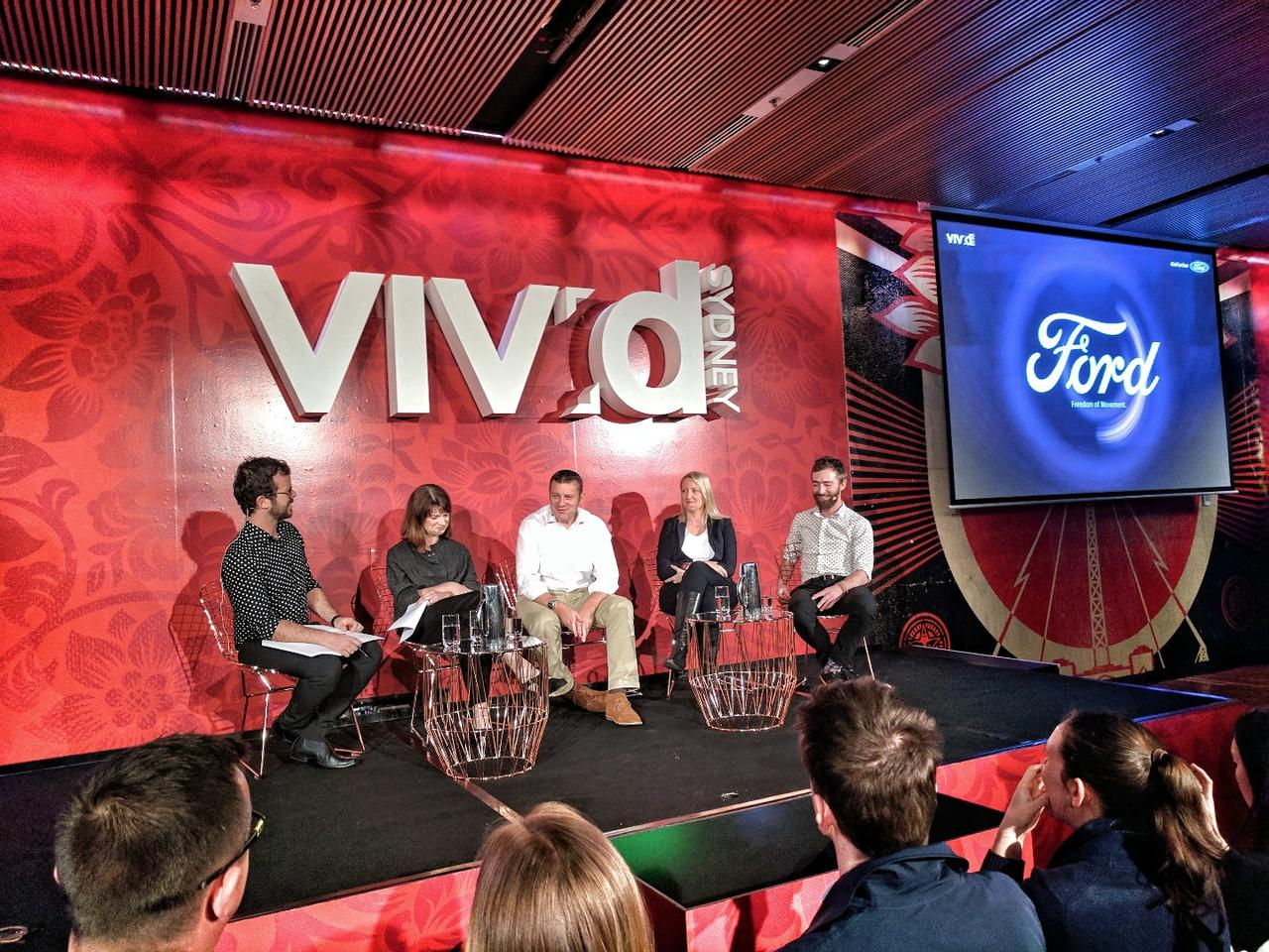 Ford Australia President and CEO Graeme Whickman (centre) with fellow panellists Bryony Cooper (left) and Catherine Ball (right) and moderators at a future mobility workshop as part of Sydney's Vivid street festival.