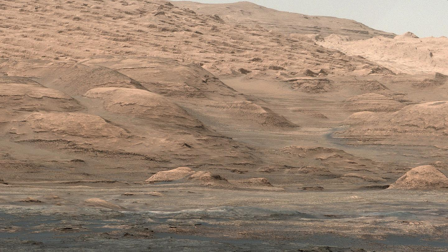 A close-up of Mount Sharp, a mound inside a crater whose formation was recently decoded by a team of researchers