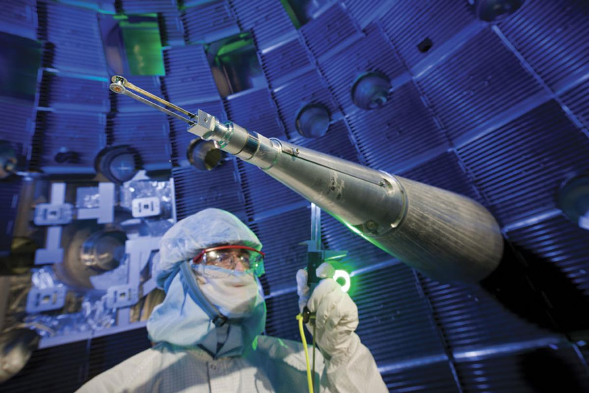 A NIF technician checks the target positioner, which precisely centers the target inside the target chamber (Image: NIF)