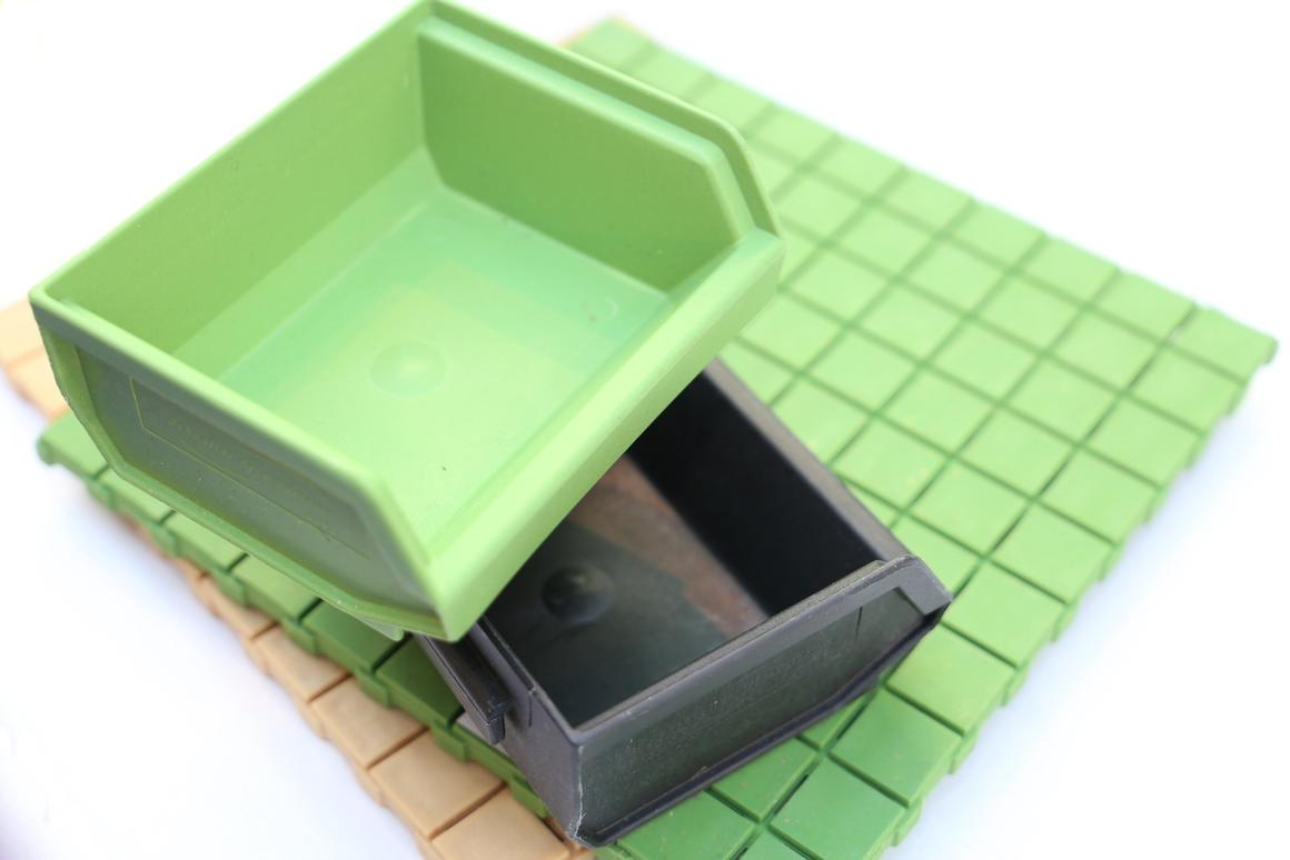 Plastic tiles and containers, made from 30 percent paper and cardboard waste