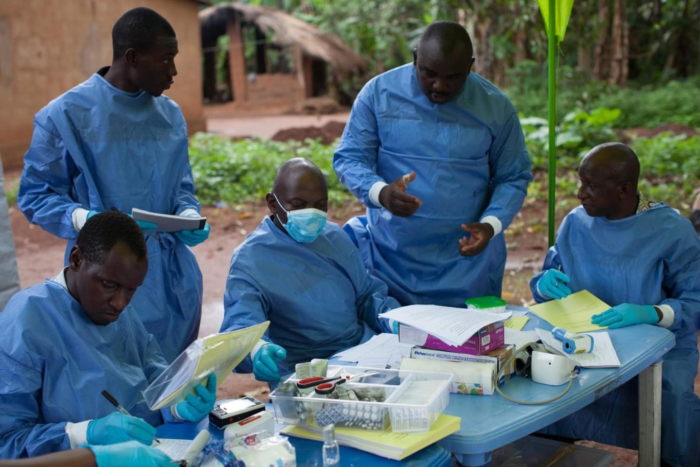 Workers carrying out the WHO Ebola vaccine trial in Katongourou, Guinea