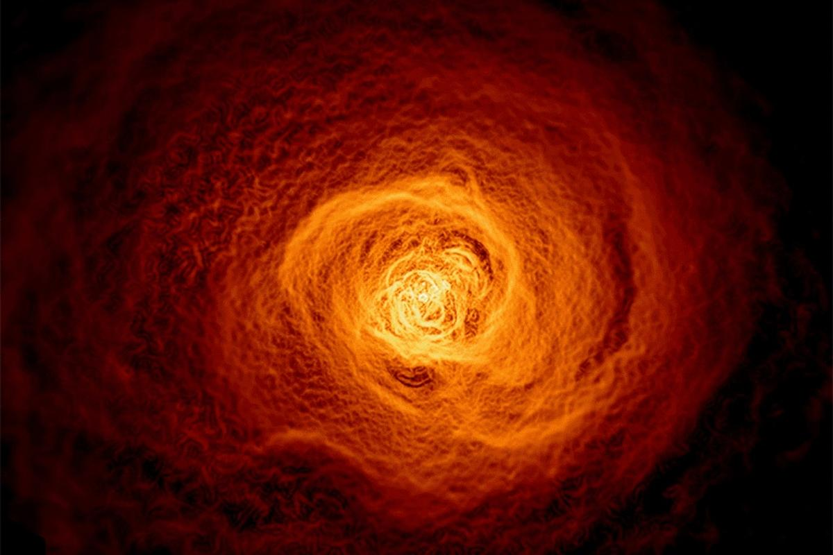 In the bottom left of this X-ray image of the Perseus galaxy cluster, a bay-shaped structure is believed to be a huge wave, 200,000 light-years across, rippling through a hot gas cloud