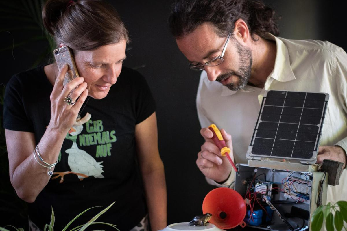 Researchers Anke Marie Hoefer and Adrian Garrido Sanchis test the FrogPhone