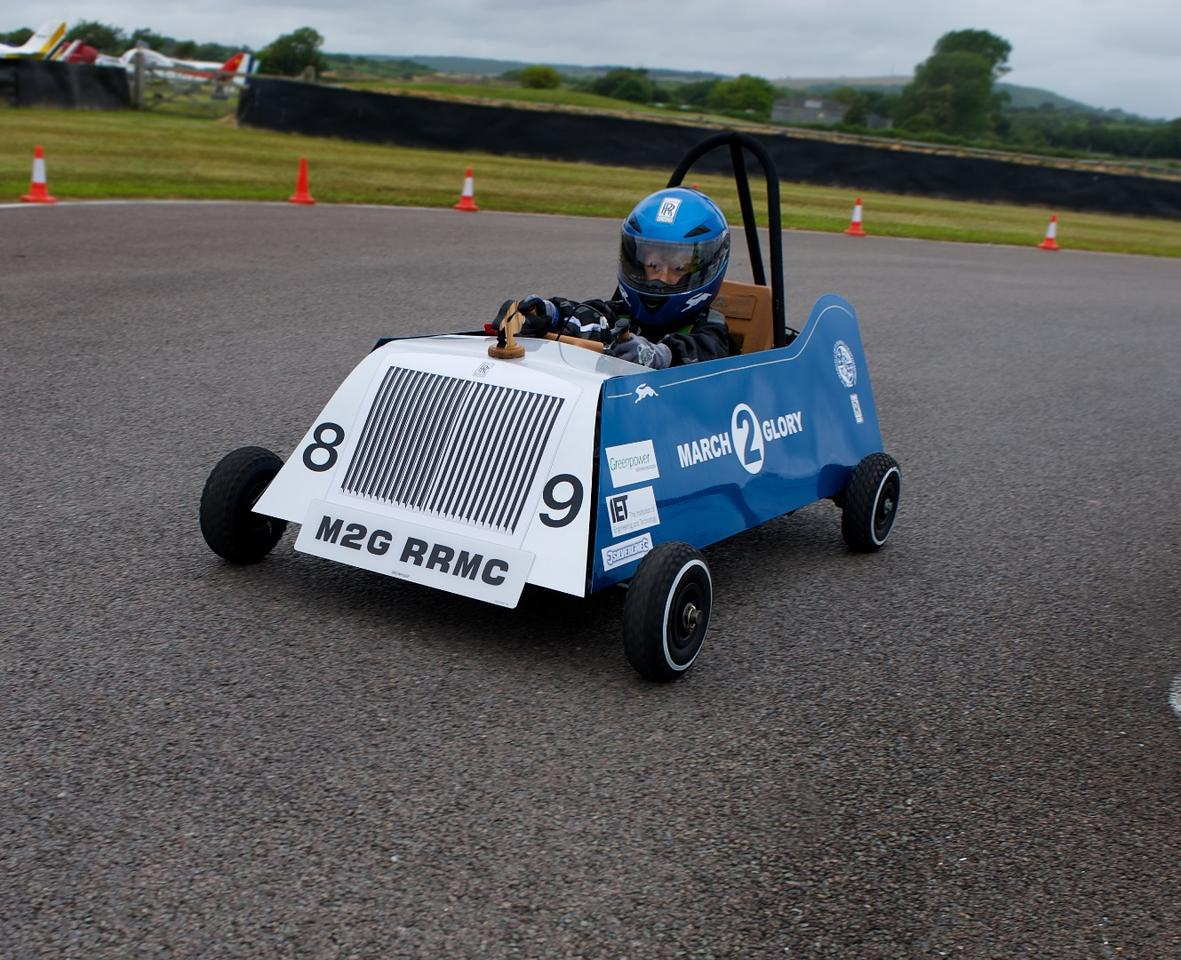 The little go-kart is powered by an electric drive