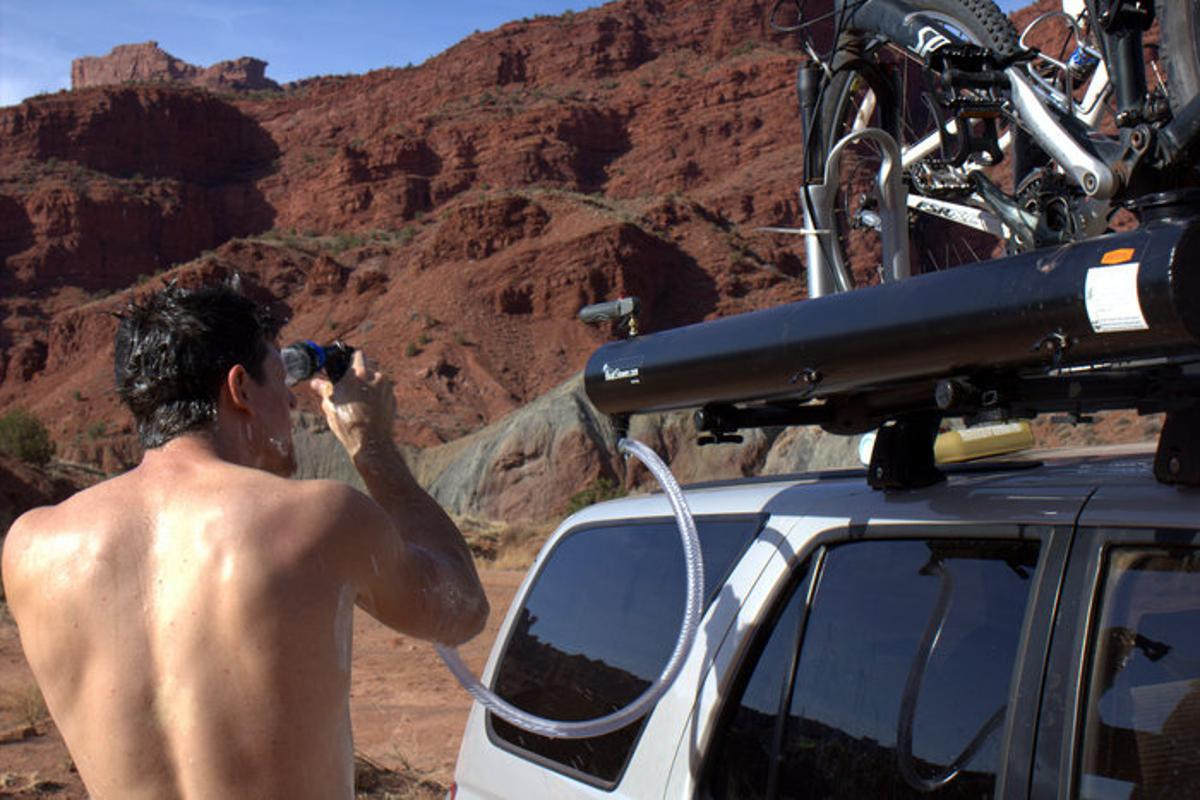 The Road Shower uses the Sun to heat its matte-black water tank