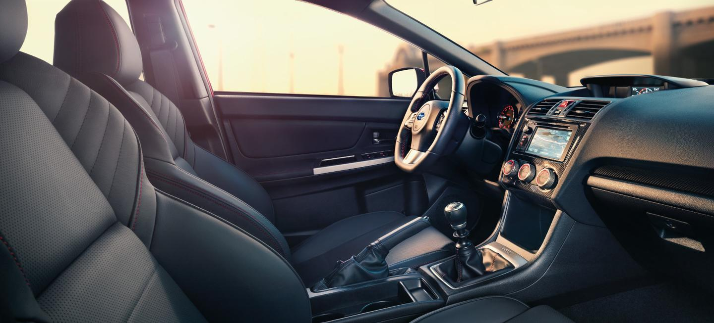 Upgraded interior of the WRX features new seats and steering wheel