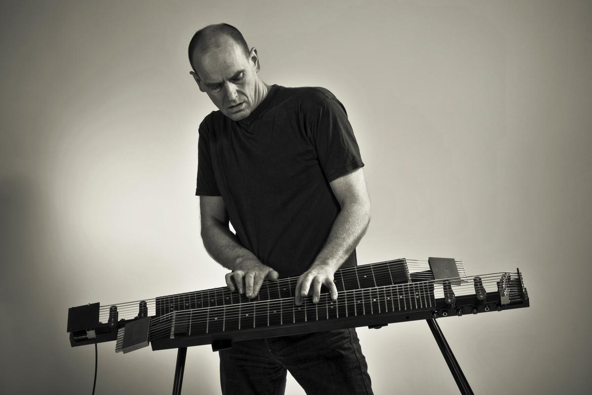 The Kelstone 9-string instrument can be played using both hands, like a piano
