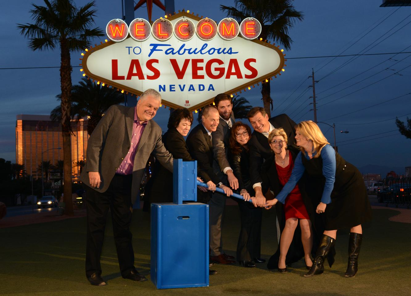 Local luminaries fire up the now solar-powered Las Vegas sign