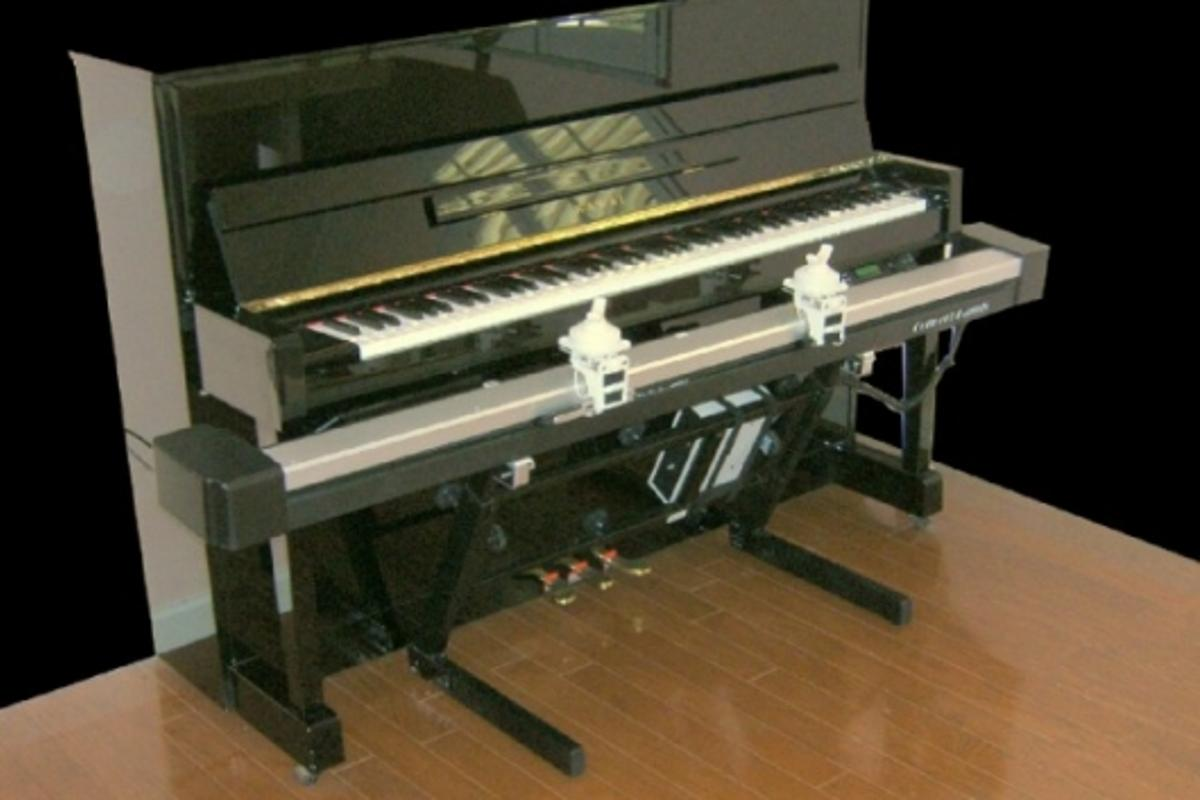 The Concert Hands track and wrist guides in front of a piano, waiting for you to start learning