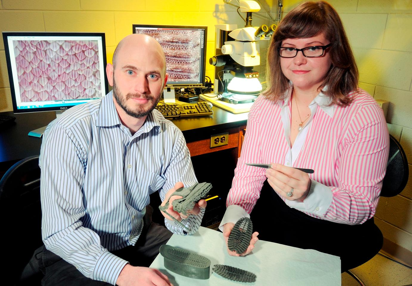 Jason Nadler and Allison Mercer with 3D rapid prototypes of the remora's adhesive disk