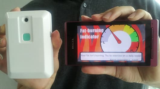 The portable prototype that detects if you're burning fat by analyzing your breath (Photo: NTT DOCOMO)