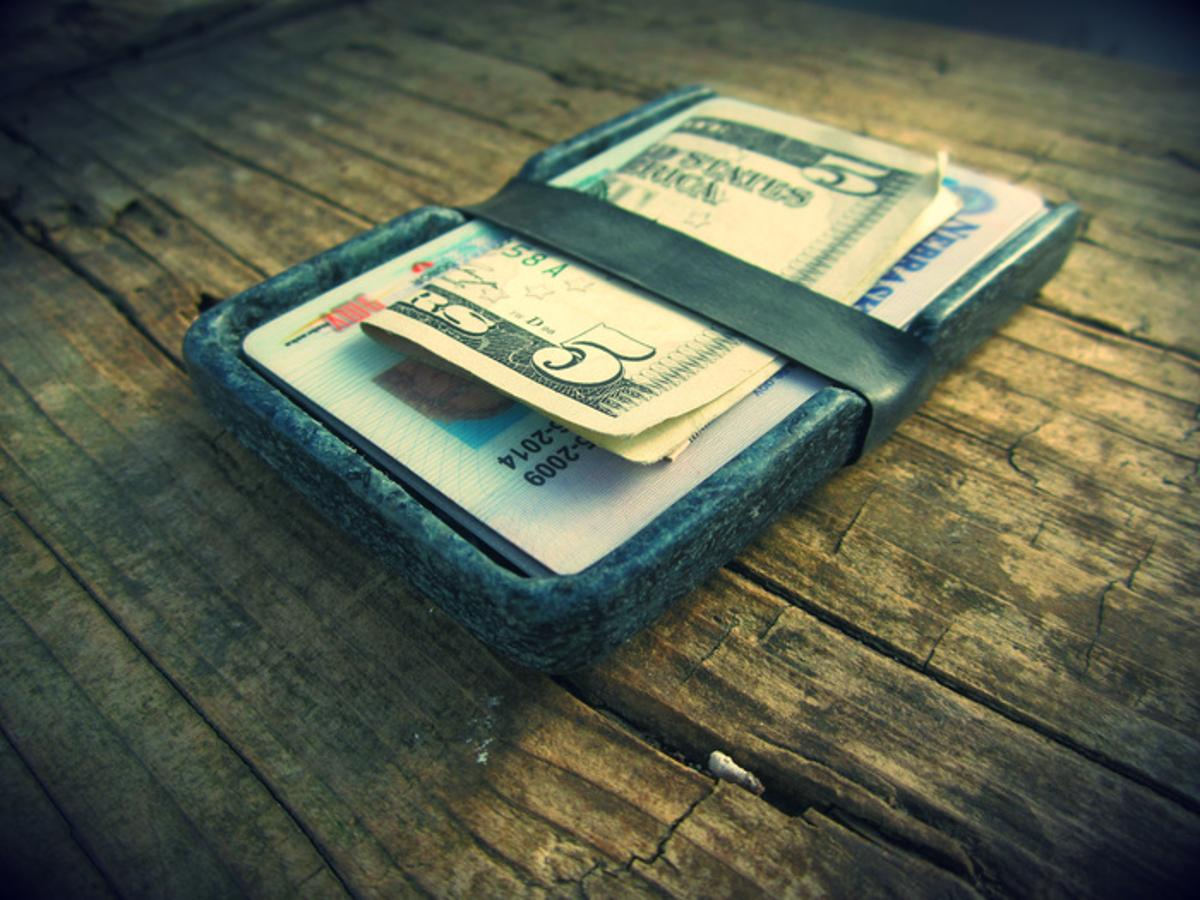 A Denimite wallet, with a band made from a recycled bicycle inner tube