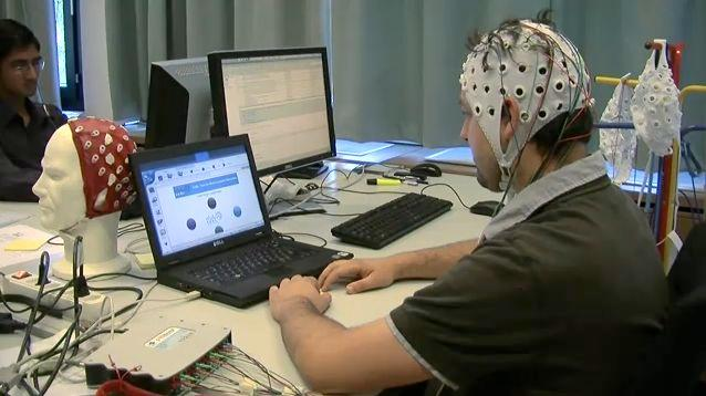 Scientists are creating a brain-computer interface that will allow users to control devices, without having to continuously concentrate on doing so (Image: EPFL)