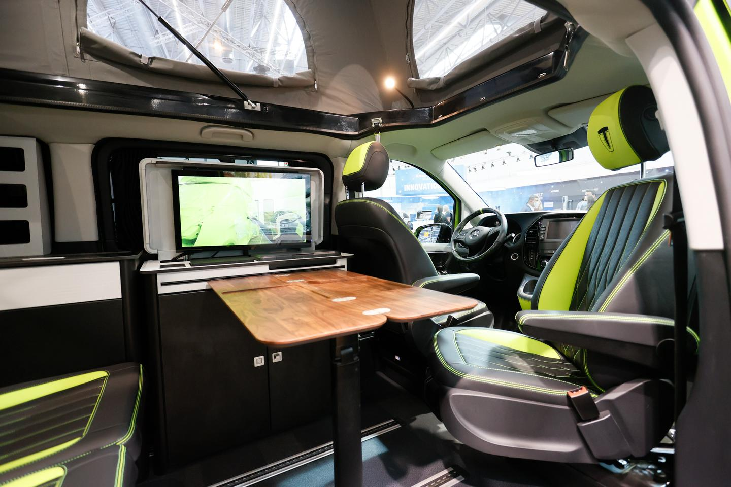 The office unit presses up against the driver's seat more than the kitchen, but the passenger seat still swivels around to complete a three-person work space
