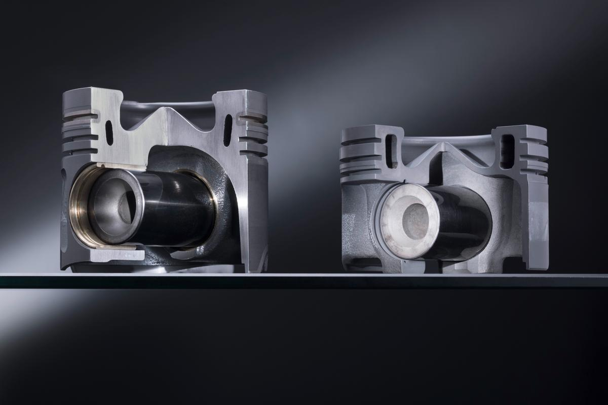An aluminum piston (left) and one of the new steel pistons (right)