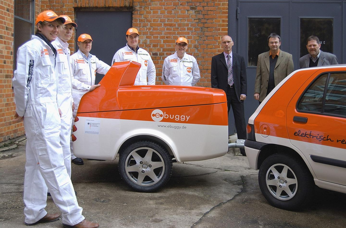 Some of the ebuggy team with one of their trailers
