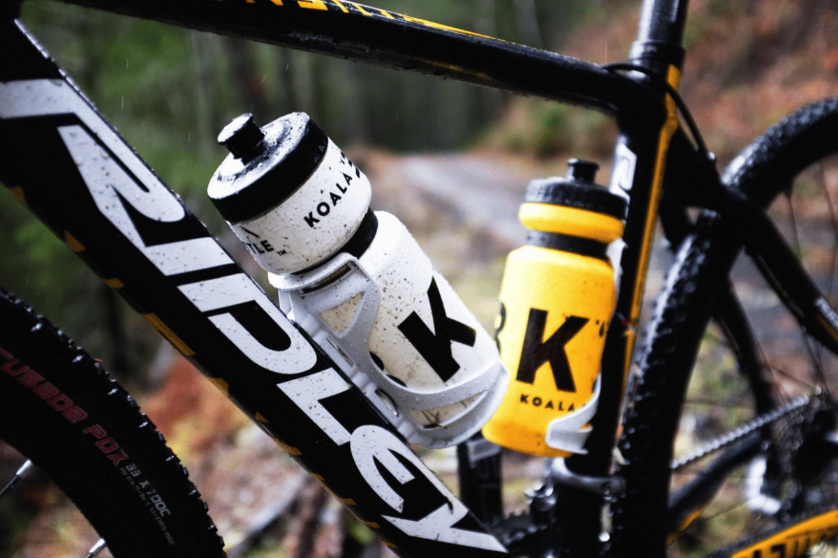 The Koala Bottle system uses magnets to hold its bottle in place on the user's bike