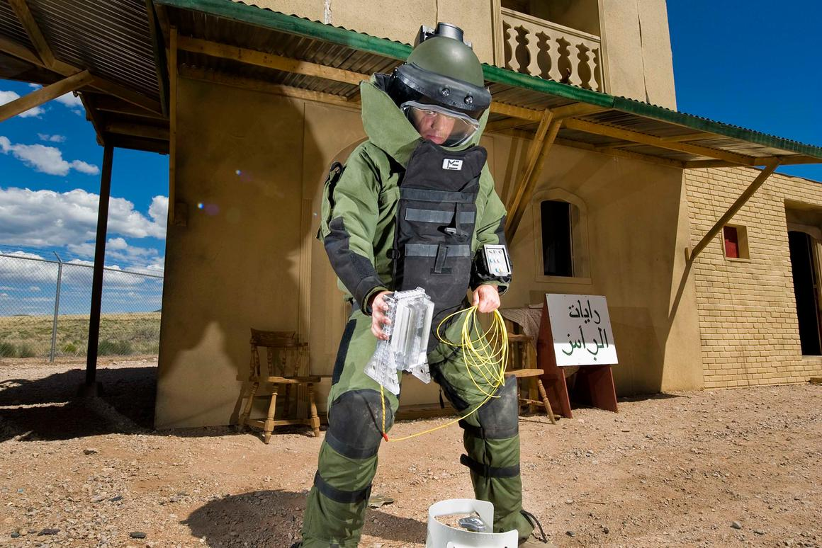 Airman 1st Class Patrick Connolly of Dayton, Ohio, demonstrates the placement of the water disruptor in a simulated village used to train soldiers heading overseas (Image: by Randy Montoya)