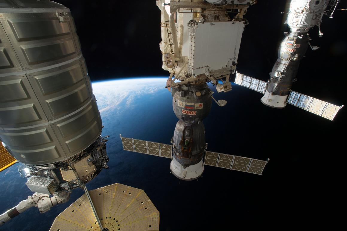 Spacecraft docked at the International Space Station, the largest human-built structure in space