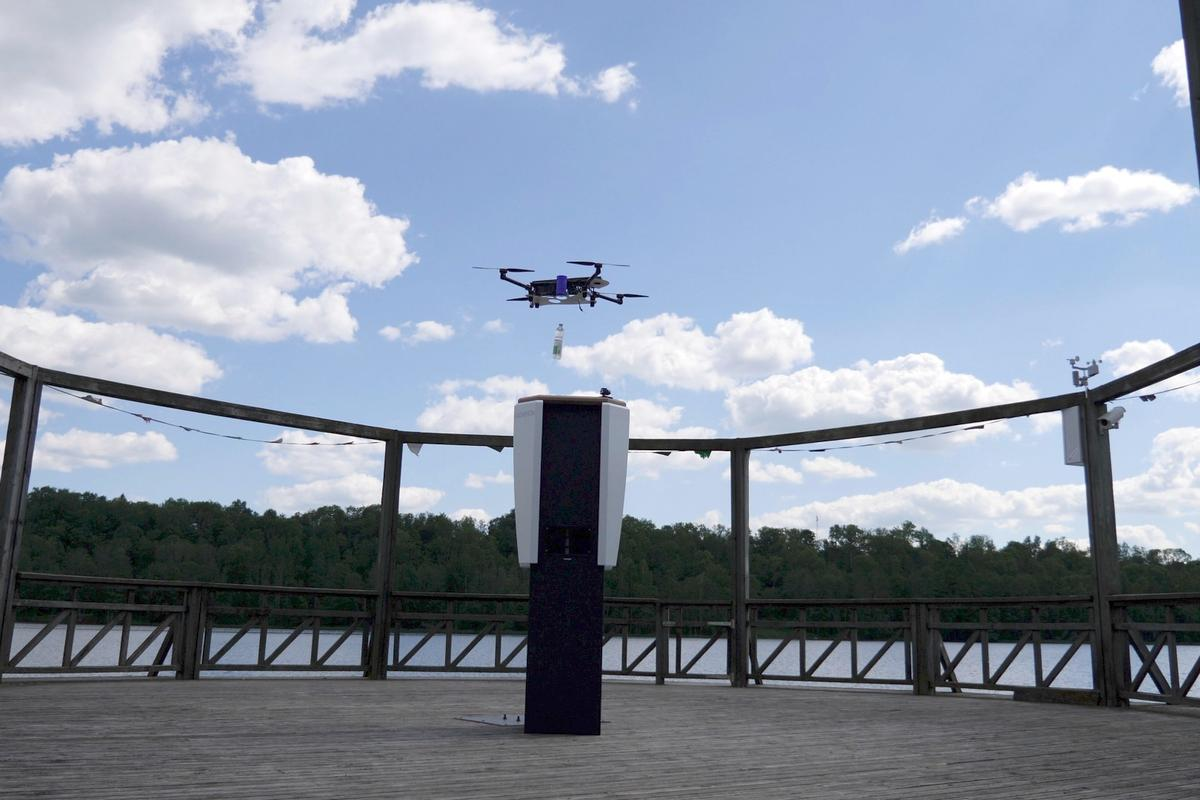 A quadcopter drops a bottled beverage into the CleverNest