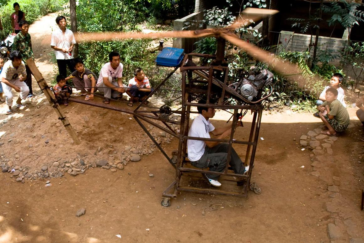 20-year-old Wu Zhongyuan from China demonstrates his home-made helicopter