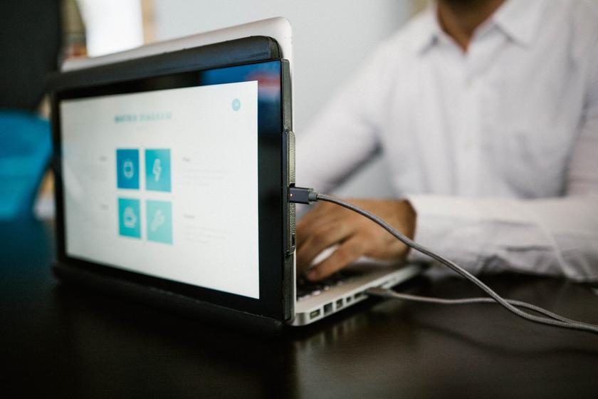 Duo adds a slide-out second screen to laptops