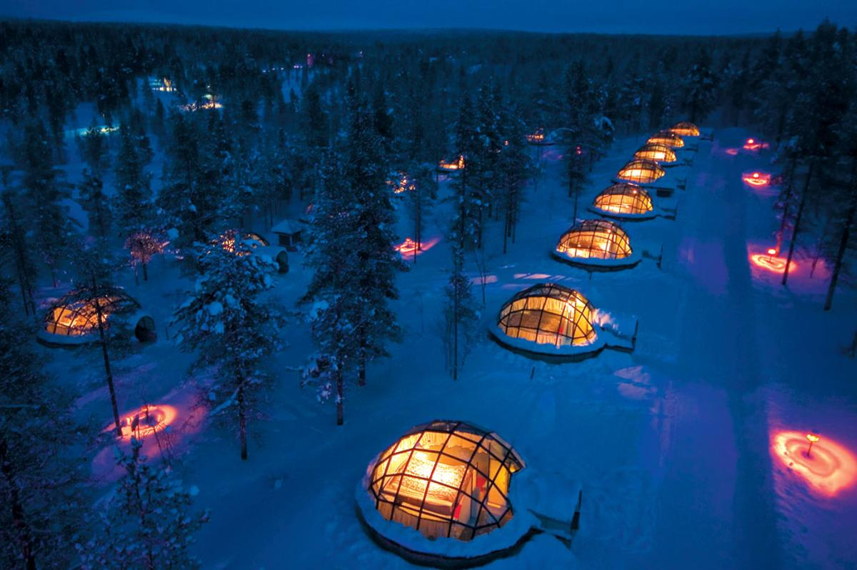 Located in the Arctic Circle, Igloo Village features glass-roofed igloos from which guests can watch the northern lights (image from Hotel Kakslauttanen)